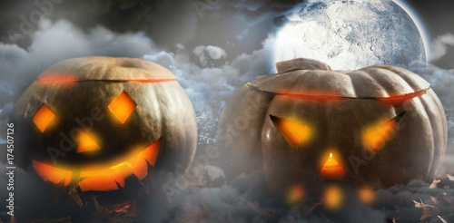 Composite image of leaves with jack o lantern on table Plakat