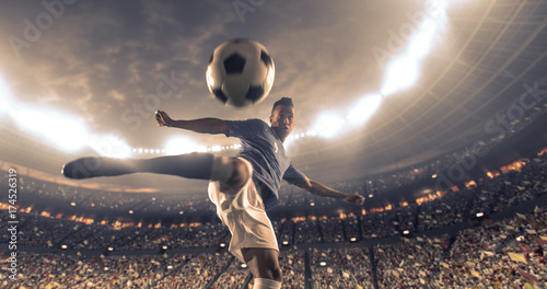 Soccer player kicks the ball on the soccer stadium Wallpaper Mural