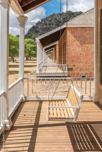 Fototapeta View along several porches with white swings obraz na płótnie