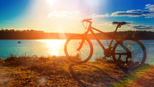 Bicycle Silhouette At Sunset Lake, In Autumn, Beautiful Landscape