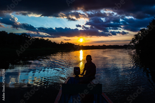 Reflection of the sun at sunset in the Limoncocha lagoon in the Ecuadorian Amazo Canvas Print