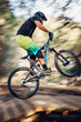 Mountain bike rider jumps on a hill