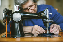 Senior Woman Working On A Sewing Machine