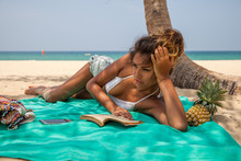 Beautiful Woman Reading A Book At The Beach