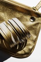 Golden Bracelet And Purse