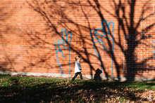 Child In Front Of Peace Sign Graffiti