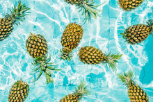 Pineapples In A Swimming Pool.