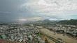 Timelapse Panoramic View City Crossed by River against Mountains