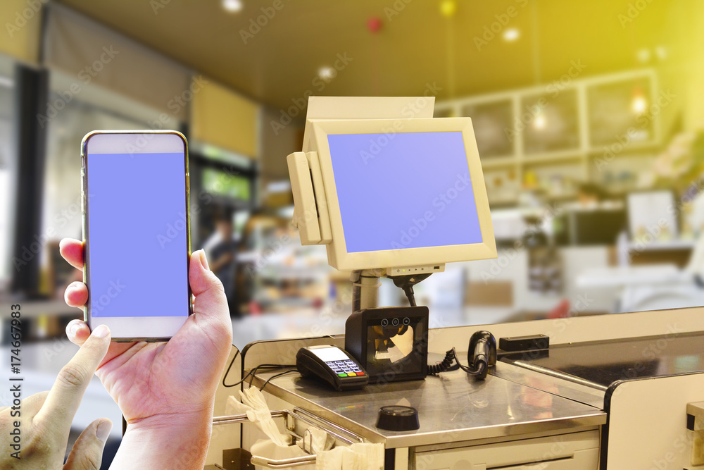Photo & Art Print POS point of sale machine and Hand holding