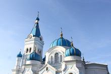 Beautiful White Church Towers With Blue Roof.