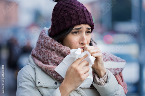 Woman coughing in winter Canvas Print