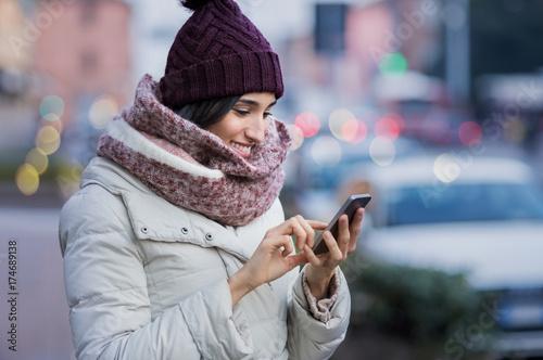 Woman using smartphone Canvas Print