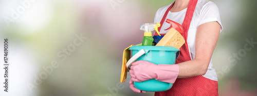 Fotografie, Obraz  Maid holding a bucket with cleaning equipment