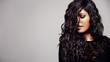 Leinwandbild Motiv Sensual woman with shiny curly hair