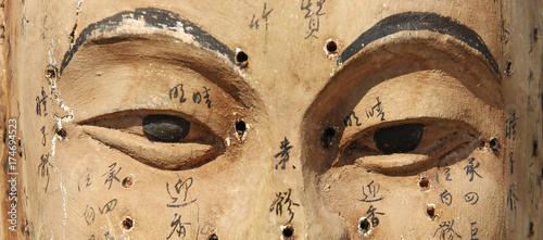 Ancient wooden face showing acupuncture points Canvas Print
