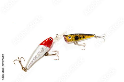 Fotografía  handmade yellow and silver,red wooden bait fish isolated on white background