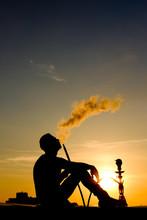 Silhouette Of Man Smoking Hook...