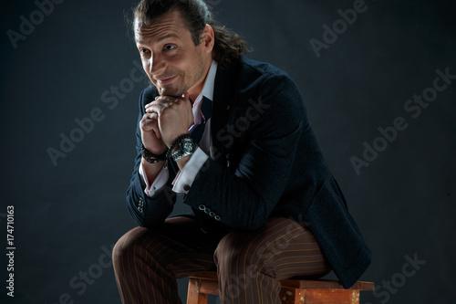 Fotografie, Obraz  Businessman sitting on an armchair