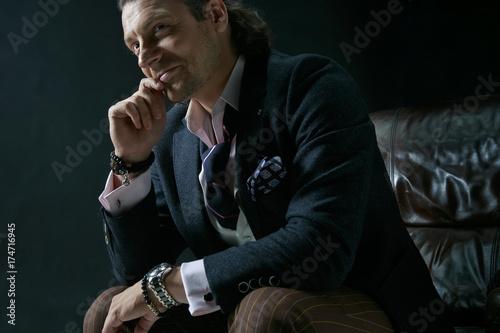 Obraz na plátně  Businessman sitting on an armchair