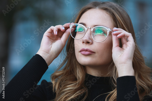 Myopia, close-up portrait of young woman student in eyeglasses for good vision l Canvas Print