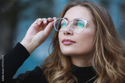 Fotomural Myopia, close-up portrait of young woman student in eyeglasses for good vision l