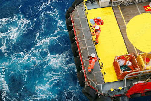 Supply boat transfer cargo to oil and gas industry and moving cargo from the boat to the platform, boat waiting transfer cargo and passenger between oil and gas platform for hard work in offshore.