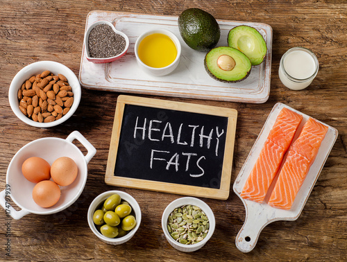 Fotografija Selection of healthy fat sources on wooden background