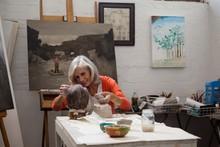 Attentive Senior Woman Making ...