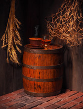Glass Of Cognac With Barrel In...