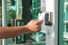 Hand Using Security Key Card S...