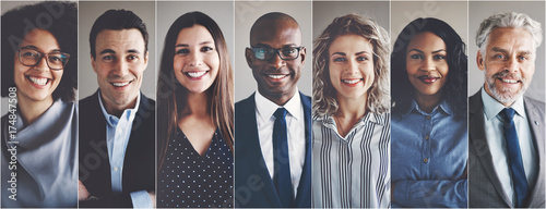 Smiling group of ethnically diverse businessmen and businesswome