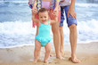 Couple with little daughter on beach
