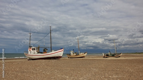 Papiers peints Scandinavie Fishing boats on a cloudy summer day. Scene at Thorup beach, west coast of Denmark.