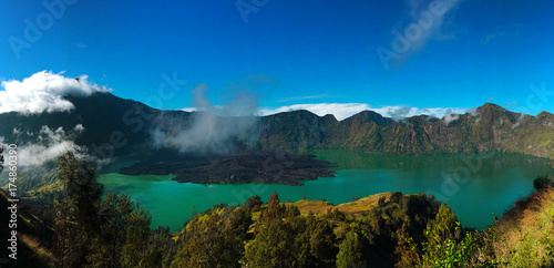Spoed Foto op Canvas Canada Colorful panorama view of the crater in Rinjani mount in Lombok, Indonesia on a nice sunny day and blue sky