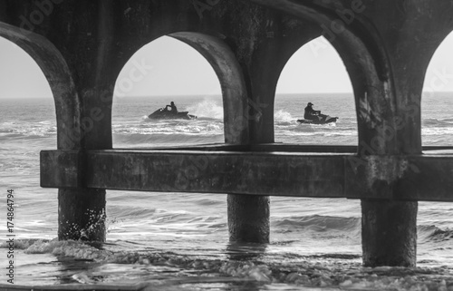 playing on jetskis near pier