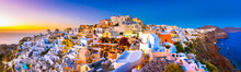 Panoramic View Of Oia Town, Santorini Island, Greece At Sunset.