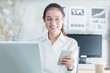 New generation business woman using smartphone,Asian woman are happily working in the office