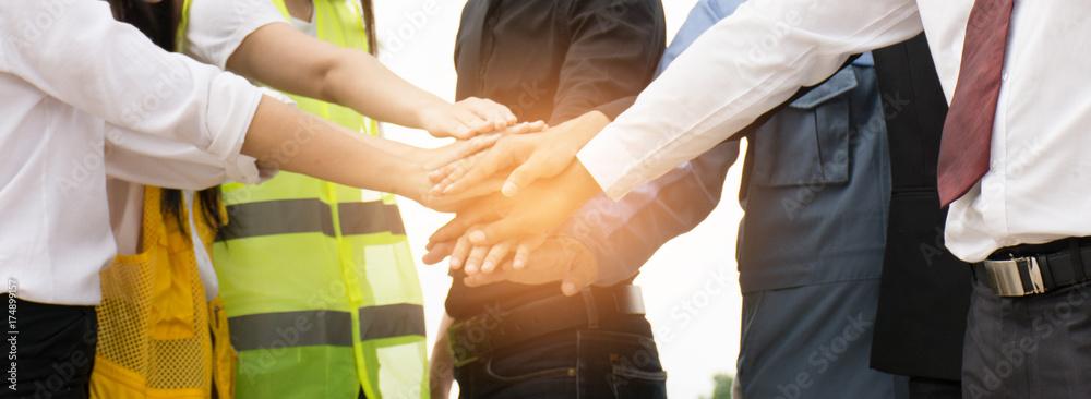 Fototapeta Businessmen and engineers join hands.