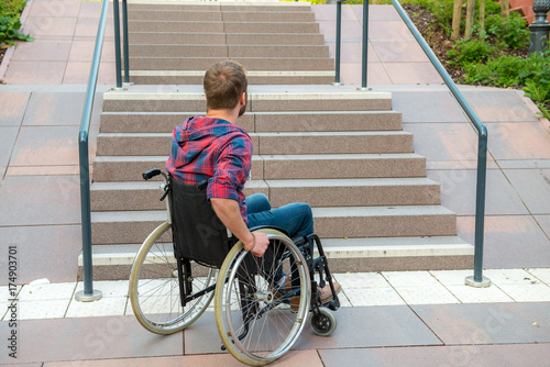 Valokuva  disabled man in wheelchair in front of stairs