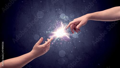 Obraz na plátně Hands reaching to light a spark