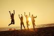 Group four friends fun beach sunset holiday