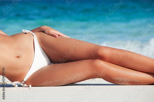 Fotografie, Obraz  Tanned woman in bikini