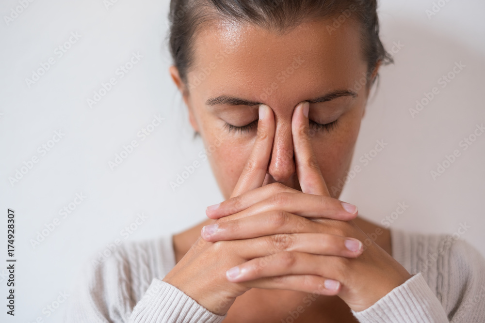 Fototapeta Portrait of young woman thinking on background