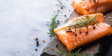 Raw Salmon Pieces On Wooden Bo...