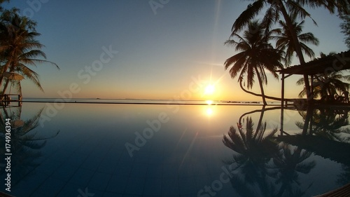 Fototapety, obrazy: Sunset with beautiful reflection at the infinity pool by the sea
