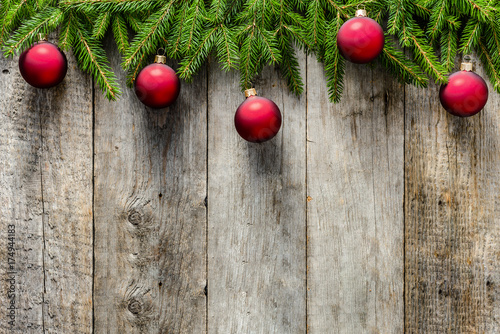 Christmas Fir Tree With Decorations On Wooden Background