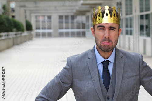 Fényképezés  Businessman wearing a crown crying with copy space