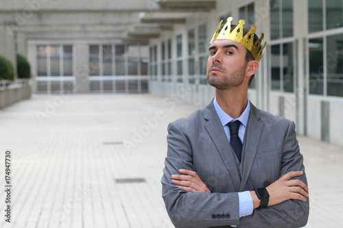 Arrogant businessman with a crown in office space Canvas Print
