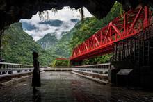 Woman Looking At The Red Bridge In Toroko National Park In Hualien, Taiwan
