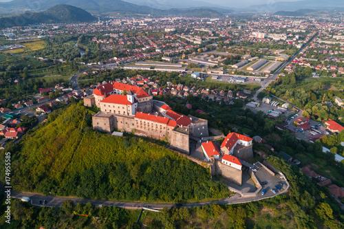 Fototapeta Aerial view of Palanok Castle, located on a hill in Mukacheve, Ukraine obraz na płótnie